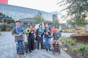 ICAre Awards team outside Google head office with Google Sign